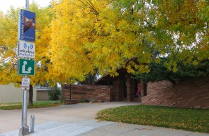Front of Greeley County Library with ash tree in autumn.