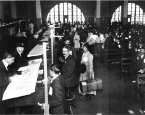 Vintage black and white photo of people researching documents.